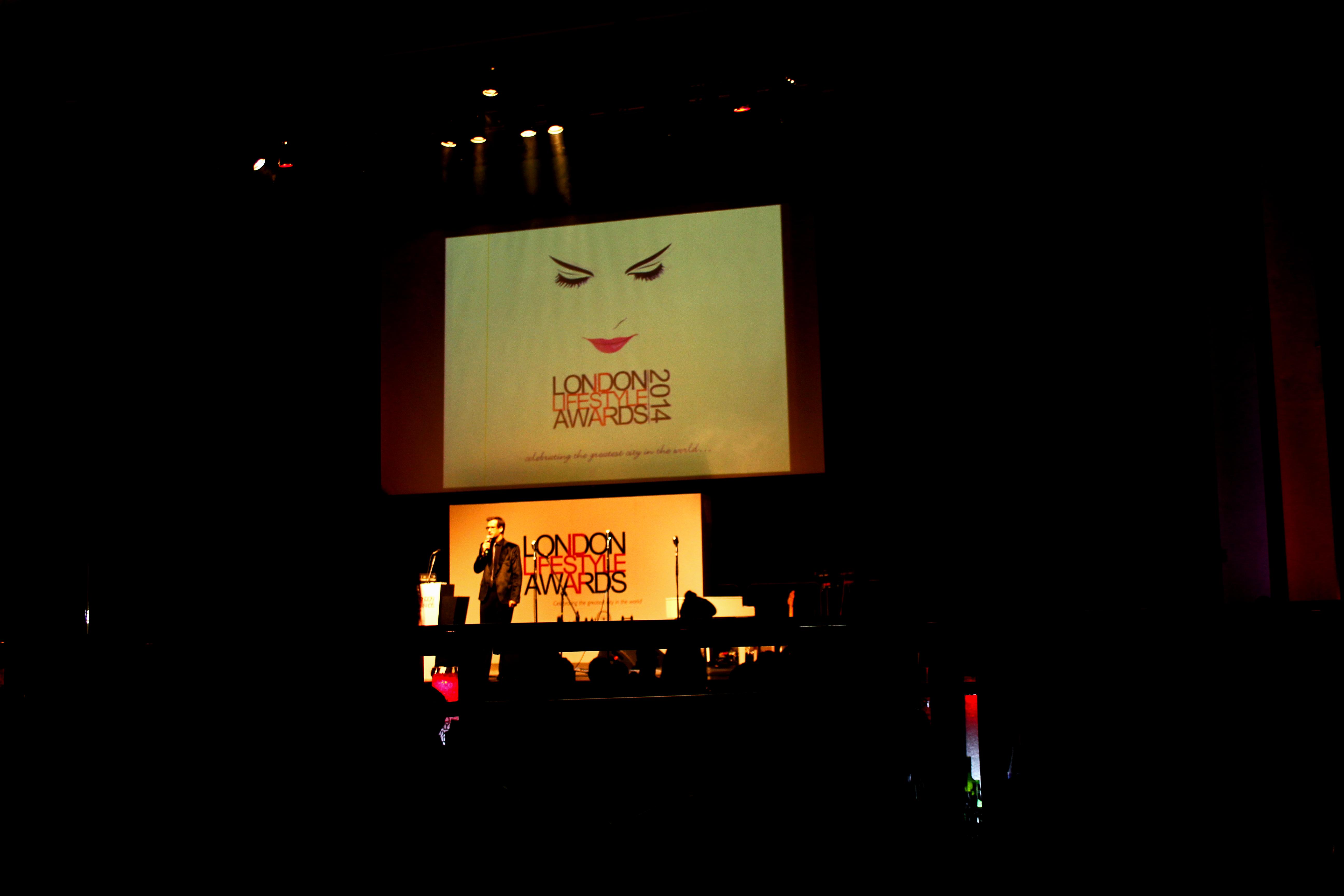Marcus Brigstocke on stage.