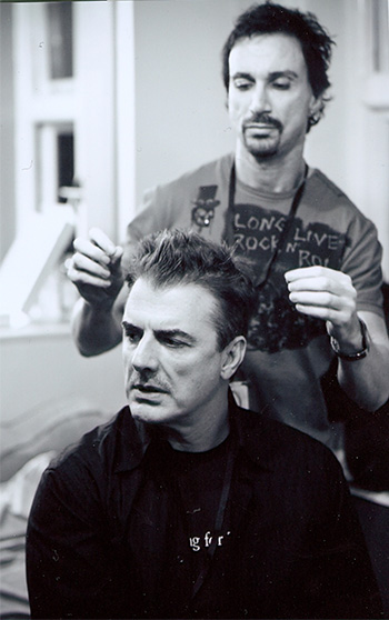Stuart cuts Mr. Big's (Chris Noth) hair