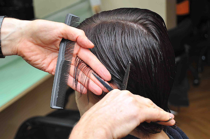 The first snip, starting at the sides to build up the shape